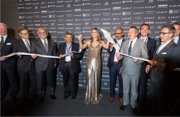 Elizabeth Hurley cuts the ceremonial ribbon to officially open CARAT+ 2018.