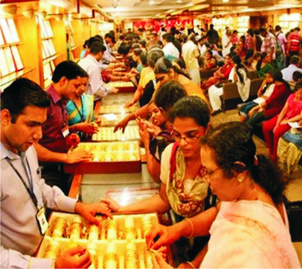 Gold continues to slide on weak global cues, muted demand