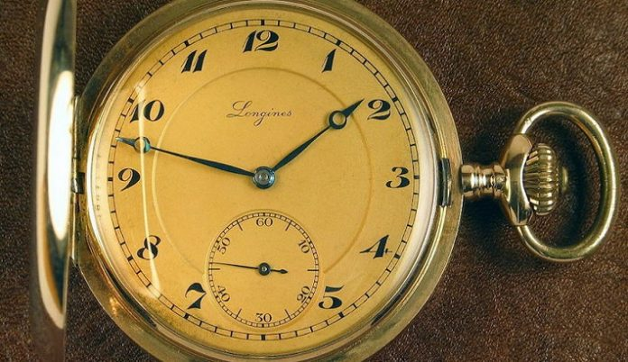 An old Longines pocket gold watch