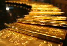 Gold eases from 1-week high as dollar nudges up
