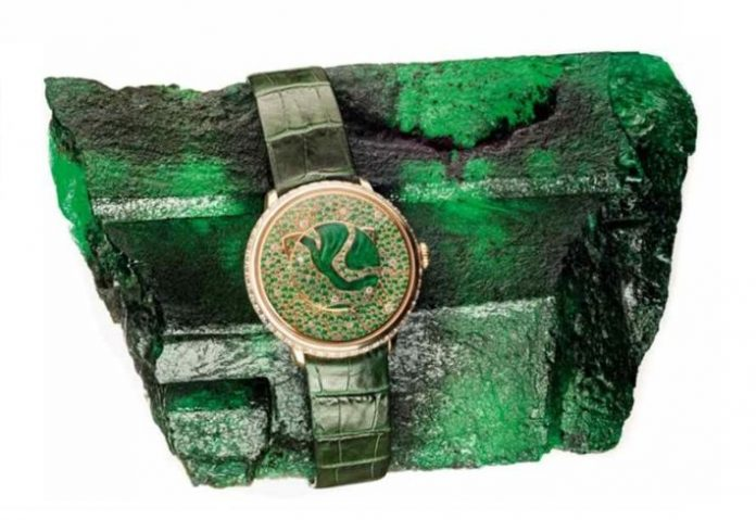Kagem is the world's largest emerald mine and source of 'Inkalamu' – the 'Lion Emerald' – a 5,655 carat Zambian emerald, picture with Fabergé's Lady Libertine II timepiece