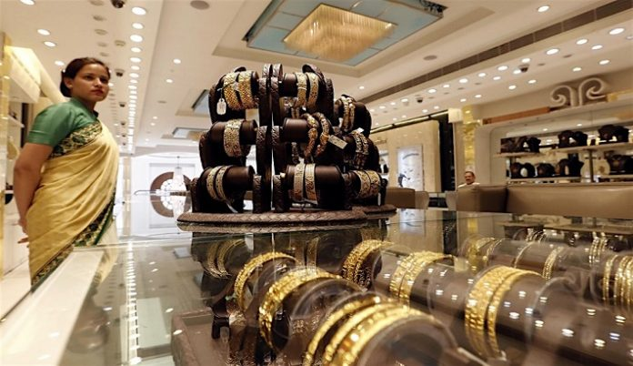 Gold price dip bolsters festive demand in India; premiums slip in China