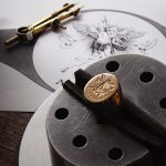 18K yellow gold signet ring by Rebus set in clamp alongside original sketch. Image courtesy of Rebus