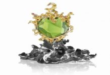 Green Genie Pendant by Naomi Sarna. 178.5 ct. peridot, with multicolored diamond, sapphire, garnet and amethyst accents, set in 18K yellow gold, on a silver presentation base.