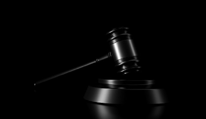 Light and shadow of gavel in the darkness. 3D rendering.