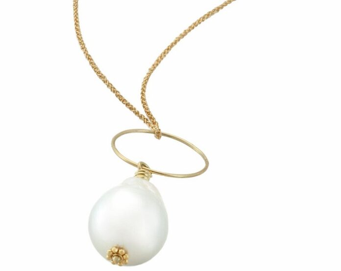Christina Malle Supports Pure Earth's Auction with Necklace